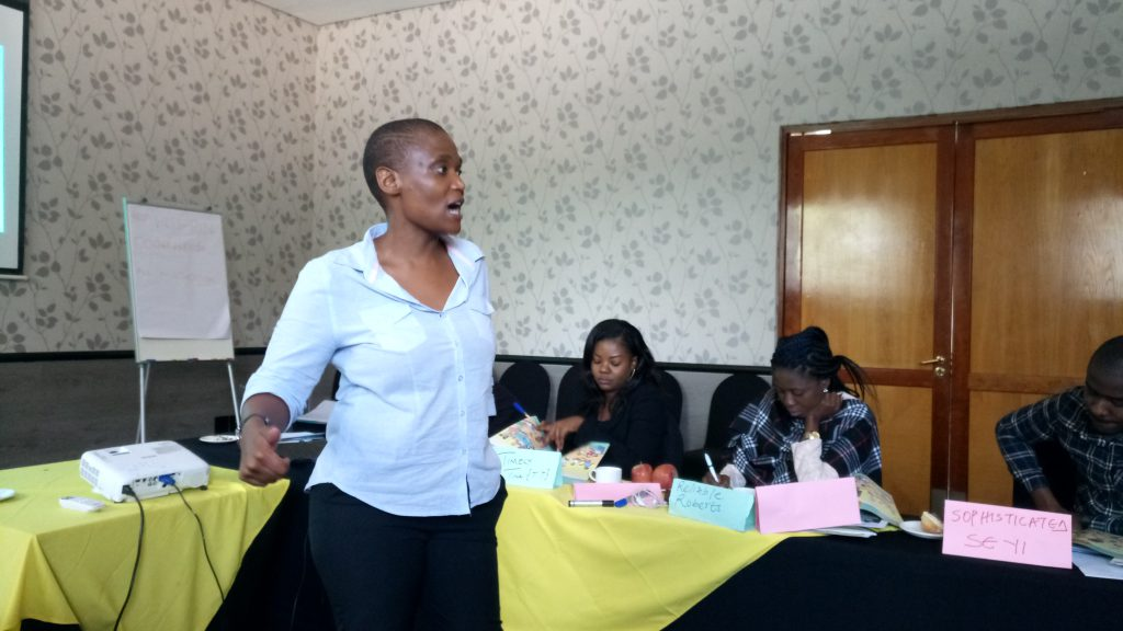 Photo 2: Ms. Thokozule Budaza of Soul City Institute for Social Justice during her presentation at the staff retreat.